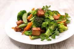 Fried tofu and vegetable. Close up on fried tofu and vegetable Royalty Free Stock Images