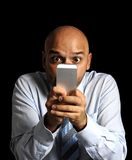 Close up friendly businessman face using compulsively online cell phone Royalty Free Stock Image