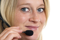 Close-up of friendly female Call Center Agent. Call Center Agent express happiness Stock Images