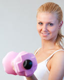 Close-up of a friendly woman trained with weights Stock Photo