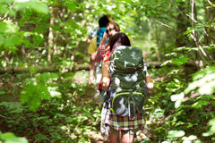 Close up of friends with backpacks hiking Royalty Free Stock Photos