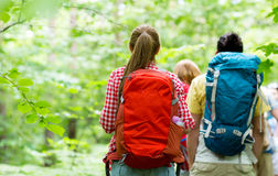 Close up of friends with backpacks hiking Stock Photos