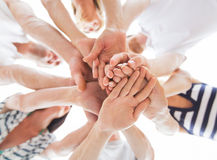 Close up of friends with hands on top Stock Images