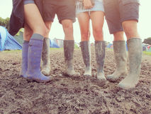 Close Up Of Friends In Wellington Boots Walking To Festival Stock Photography