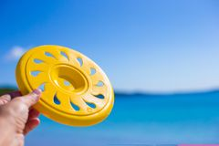 Close up frisbee background a tropical beach and. Close up frisbee against a tropical beach and sea Royalty Free Stock Image