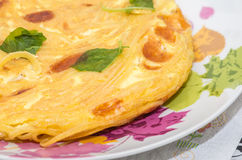 Close-up of a frittata of pasta with basil leaves Royalty Free Stock Photography