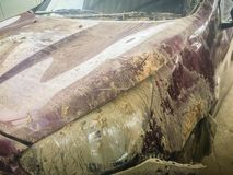 Close-up front of dirty car distorted by accident. Crashed dirty Stock Photography