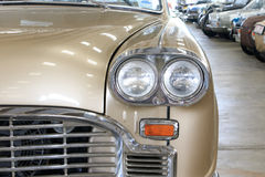 Close Up of Front Light Details of a Gold Vintage Car Royalty Free Stock Image