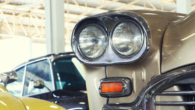 Close Up of Front Light Details of a Gold Vintage Car Royalty Free Stock Photo
