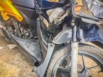 Close-up front of new motorcycle distorted by accident. Crashed Royalty Free Stock Photos