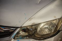 Close-up front of new silver car distorted by accident. Crashed Stock Images