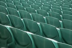 Close up of back of a green arena seats Royalty Free Stock Images