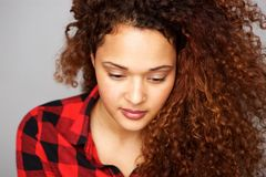 Young woman looking down. Close up front portrait of young woman looking down Royalty Free Stock Photos