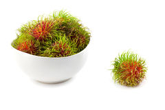 Close up front side  rambutan in dish. On white background Stock Photography