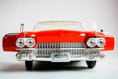 Close up front view of american classic red car. Realistic scale car model on the white background. stock image