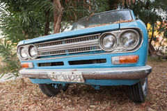 Close up front view of blue Datsun 1300 pickup Royalty Free Stock Photography