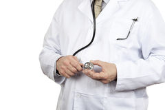Close up front view of a doctor adjusting his stetoscope. Close up front view of a doctor with his glasses in his pocket adjusting his stetoscope on a pure white Stock Images