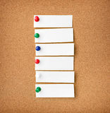 Close up front view of illustrative corkboard with blank white n Stock Image