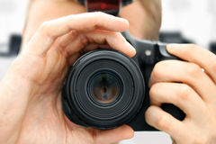 Close up front view of man holding camera Royalty Free Stock Photos