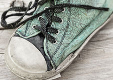 Close up front view of old worn out running shoe. Stock Photo