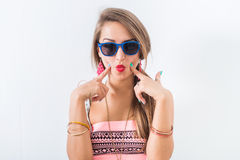 Close-up front view portrait of a gorgeous, glamorous model presenting funny high-fashion look in studio. Stock Photos