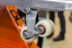 Close up front wheel of hand pallet for industrial work  lift the float out off the ground.  stock photography