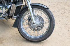 Close up front wheel motorcycle chopper  on the floor. Royalty Free Stock Image