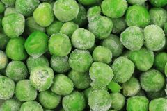 Close up of frozen Green Peas. Stock Photos