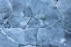Close up on frozen ice plaques on lake in wintertime, background texture. Close up on thin frozen ice plaques on lake in wintertime, background Stock Photo