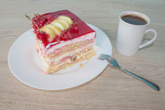Close up Fruit cake with red currant. Fruit Cake with fresh red currant on the plate Stock Photo