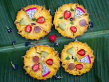 Close up fruit pizza in banana leaf Stock Photo