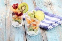 Close up of fruit salads near checked napkin Stock Photo