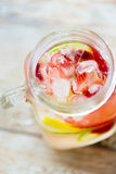 Close up of fruit water in glass bottle Royalty Free Stock Photography