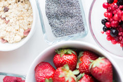 Close up of fruits and berries in bowl on table Royalty Free Stock Image