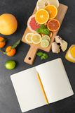 Close up of fruits and notebook on slate table top royalty free stock image