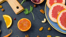 Close up of fruits, nuts and vegetables on table. Food, healthy eating and vegetarian concept - close up of fruits, nuts and vegetables on table top stock video