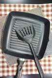 Close up frying pan and kitchen utensils on table. Stock Photo