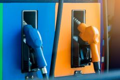 Close up fuel nozzles at gas station royalty free stock photography