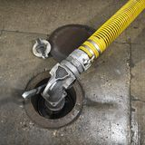 Close up of a fuel pump. Close up of a yellow fuel pump Stock Photography