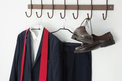 Close-up of full suit and shoes hanging on hook Stock Images