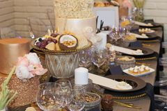 Close up of a fully set banquet table with brown and earth tones stock photo