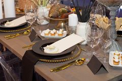Close up of a fully set banquet table with brown and earth tones royalty free stock photos