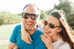 Close up funny beauty portrait of happy hipster couple royalty free stock photography