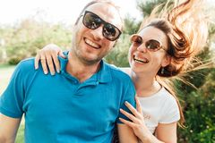 Close up funny beauty portrait of happy hipster couple royalty free stock image