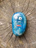 Close up of funny cartoon painted children blue stone with eyes Stock Images