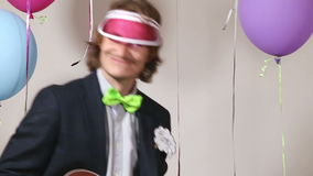 Close up of funny man playing ukulele in photo booth stock video footage
