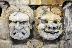 Close-up of funny soapstone masks Royalty Free Stock Image