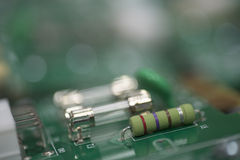 Close-up of fuse and resistor on circuit board Stock Image