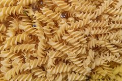 Fusilli pasta background. Close up of fusilli or rotini pasta displayed in the background in an Italian restaurant royalty free stock photography