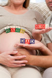 Close up of future parents holding cubes Royalty Free Stock Photo